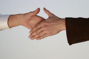 image of two people shaking hands
