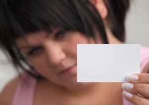 Image of a girl holding a business card