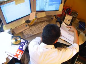 image of a man at a desk